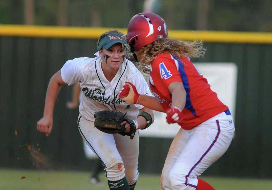 The Woodlands shortstop Aubrey Leach catches Oak Ridge's Carley Latta trying to steal in the fourth. Photo: Jerry Baker, Freelance