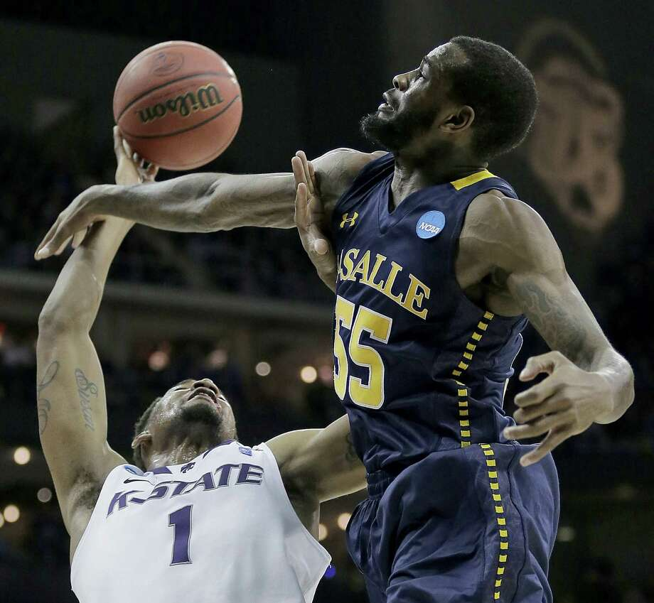 La Salle's Ramon Galloway tries to block a shot by Kansas State's Shane Southwell during the second half. The No. 4 seed Wildcats rallied from an 18-point deficit but went cold late as they fell 63-61. Photo: Charlie Riedel / Associated Press