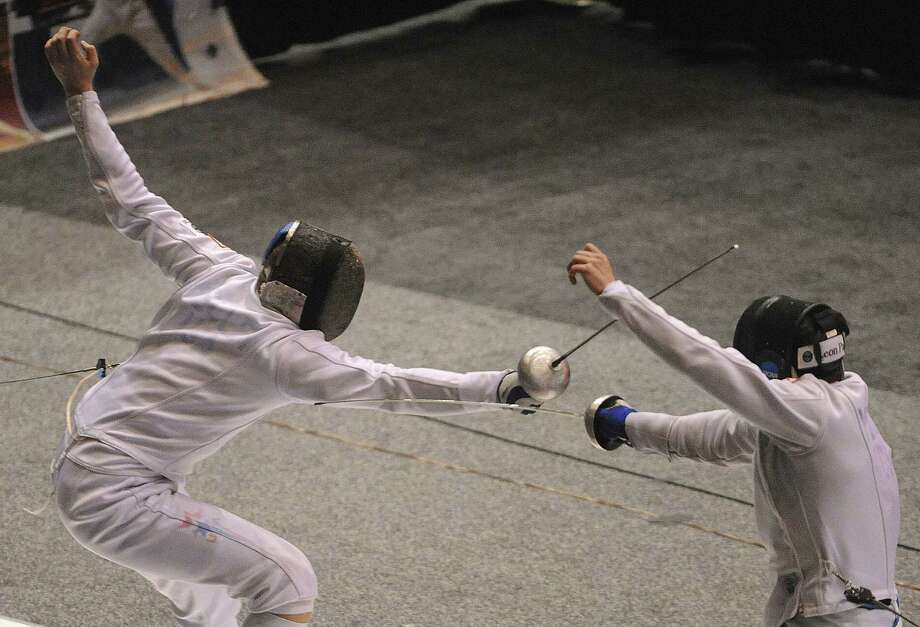 San Antonio native Ed Kelley (left) competes against Princeton teammate Jonathan Yergler in the semifinals of the men's epee competition at the NCAA Fencing Championships at Freeman Coliseum. Kelley lost 15-13 to finish in a tie for third place. Photo: Billy Calzada / San Antonio Express-News