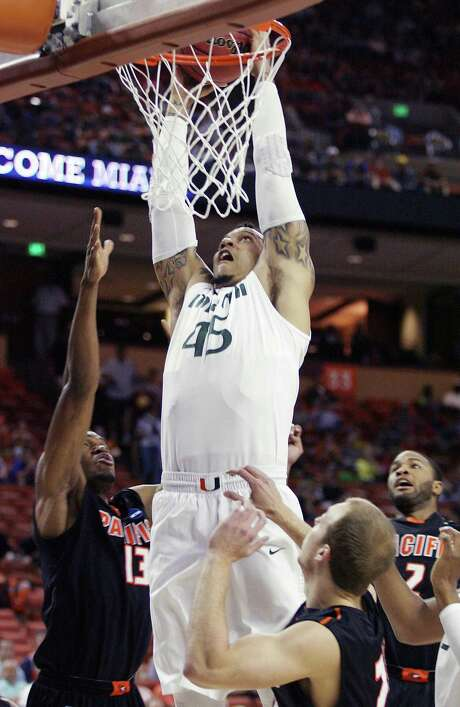 Miami's Julian Gamble goes up for a dunk as the Hurricanes blew past Pacific in the second round. It was Miami's most lopsided win ever in the tournament. Photo: Stephen M. Dowell / McClatchy-Tribune News Service