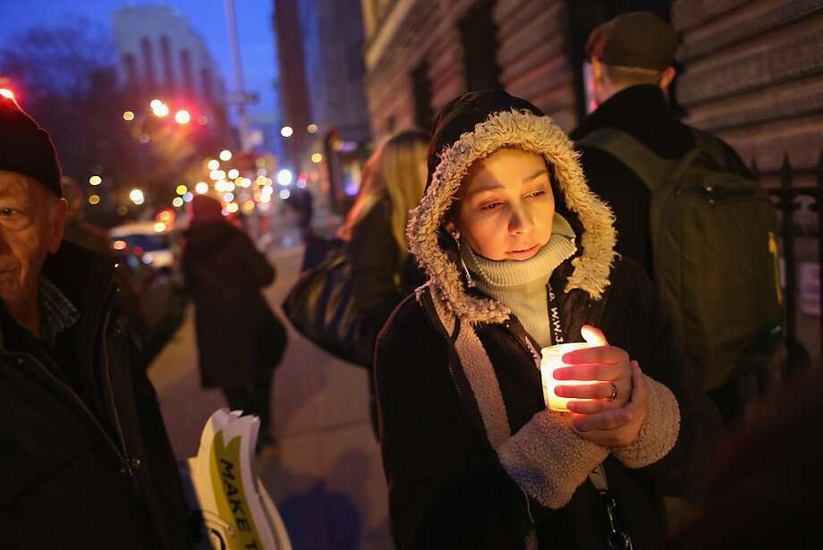 Colombian immigrant Liliana Mendez takes part in a candlelight vigil for immigration reform on March 22, 2013 in New York City. The group New Yorkers for Real Immigration Reform held the vigil to call on Congress  to introduce immigration reform that provides a path to citizenship for undocumented workers, slows the high number of deportations and protects workers while serving America's economic needs.  (Photo by John Moore/Getty Images) Photo: John Moore, Getty Images