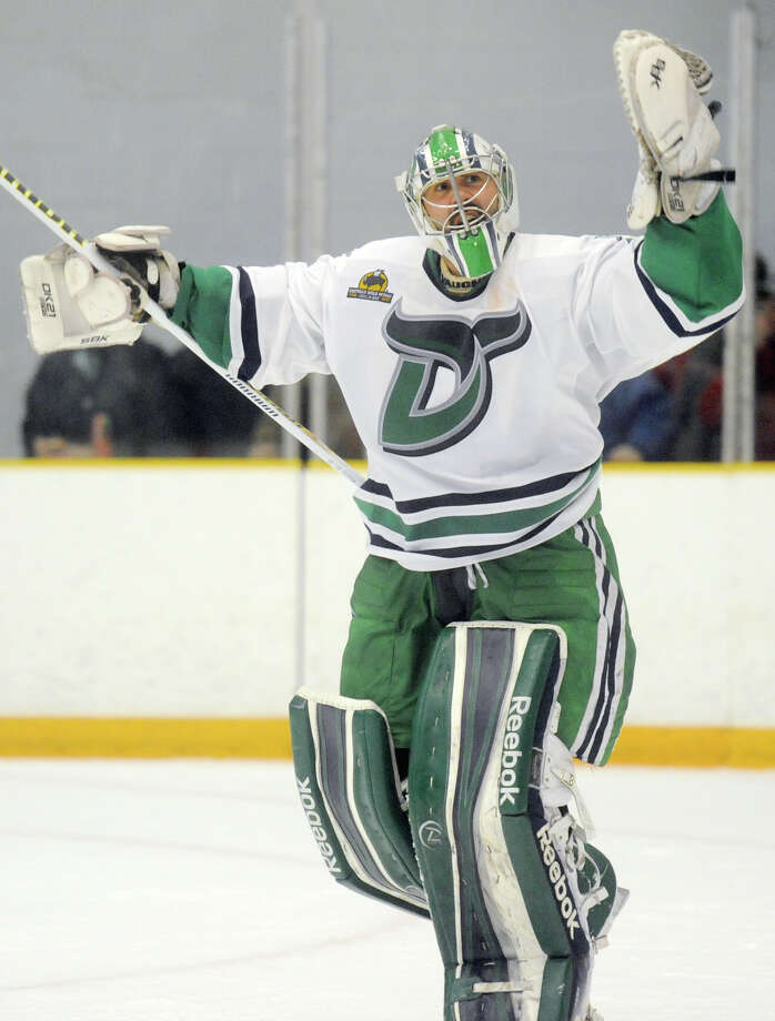Danbury goalie Mike Brown pumps up the crowd at the end of the second period in game three of the Commisioner's Cup championship series between the Danbury Whalers and the Dayton Demonz at Danbury Arena in Danbury, Conn. on Friday, March 22, 2013. Photo: Tyler Sizemore / The News-Times