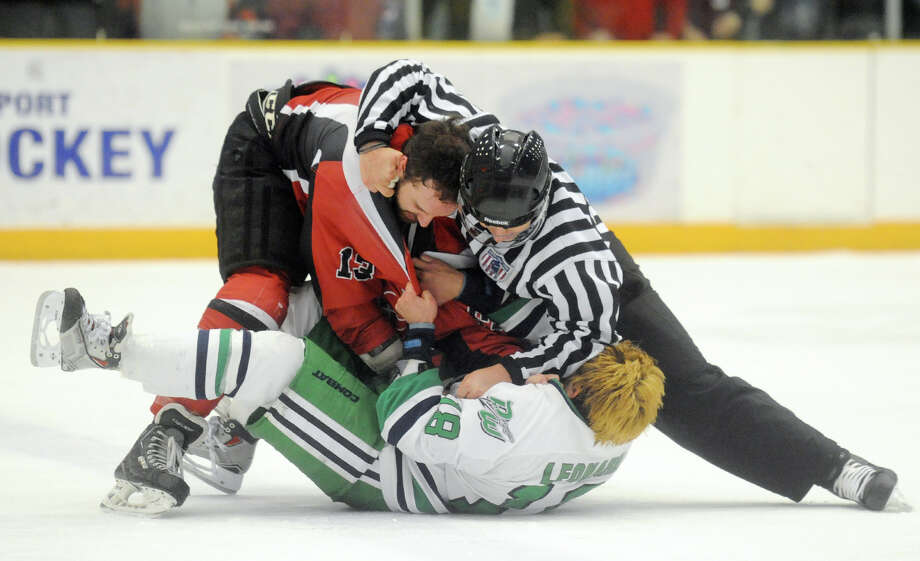 A referee breaks up a fight between Danbury's Brett Leonard and Dayton's Brayden Metz during the Danbury Whalers' 6-3 win over the Dayton Demons in the Commisioner's Cup finals at Danbury Arena in Danbury, Conn. on Friday, March 22, 2013. Photo: Tyler Sizemore / The News-Times