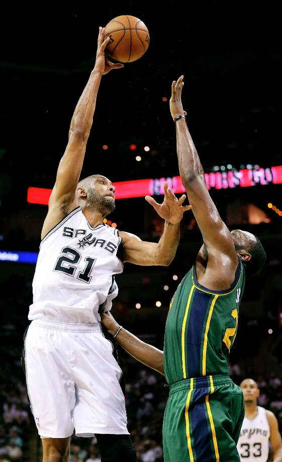 The Spurs' Tim Duncan shoots over Utah Jazz's Al Jefferson during first half action Friday, March 22, 2013 at the AT&T Center. Photo: Edward A. Ornelas, San Antonio Express-News / © 2013 San Antonio Express-News