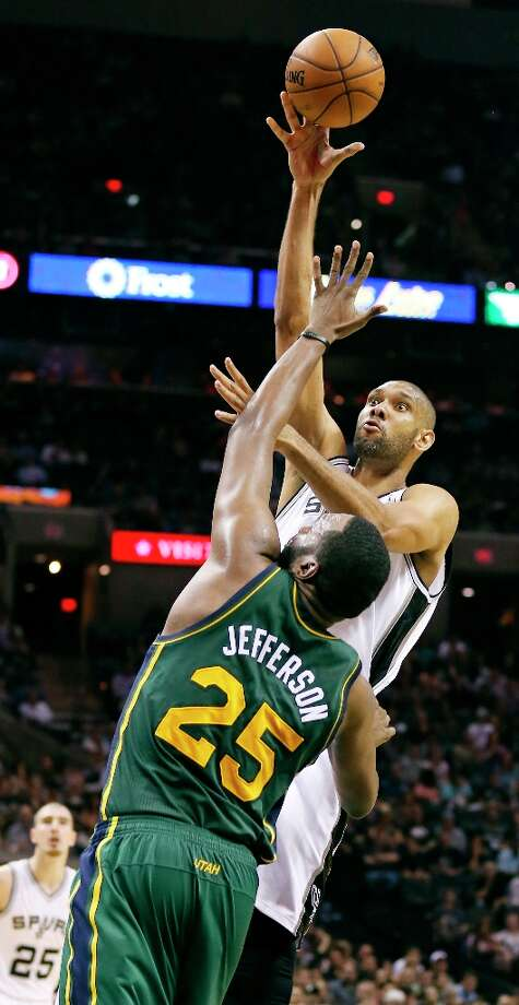The Spurs' Tim Duncan shoots over Utah Jazz's Al Jefferson during second half action Friday, March 22, 2013 at the AT&T Center. The Spurs won 104-97 in overtime. Photo: Edward A. Ornelas, San Antonio Express-News / © 2013 San Antonio Express-News