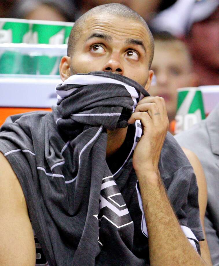 The Spurs' Tony Parker sits on the bench during second half action against the Utah Jazz on Friday, March 22, 2013 at the AT&T Center. The Spurs won 104-97 in overtime. Photo: Edward A. Ornelas, San Antonio Express-News / © 2013 San Antonio Express-News