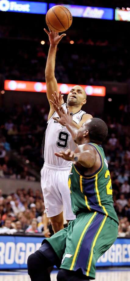 The Spurs' Tony Parker shoots over Utah Jazz's Paul Millsap during second half action Friday, March 22, 2013 at the AT&T Center. The Spurs won 104-97 in overtime. Photo: Edward A. Ornelas, San Antonio Express-News / © 2013 San Antonio Express-News
