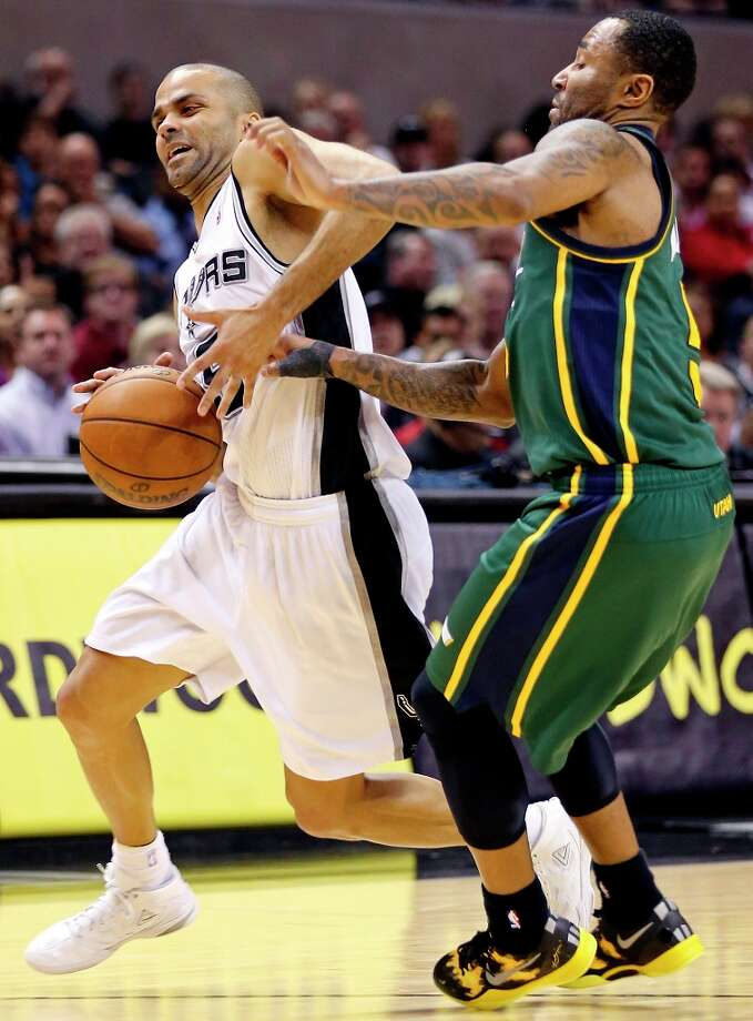 The Spurs' Tony Parker looks for room around Utah Jazz's Mo Williams during second half action Friday, March 22, 2013 at the AT&T Center. The Spurs won 104-97 in overtime. Photo: Edward A. Ornelas, San Antonio Express-News / © 2013 San Antonio Express-News