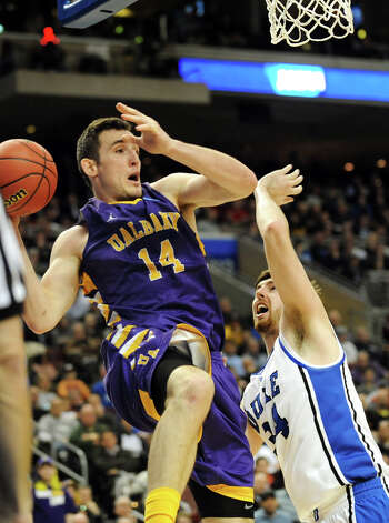 UAlbany's Sam Rowley, left, grabs the rebound as Dukes Ryan Kelly defends during their second round NCAA Tournament on Friday, March 22, 2013, at Wells Fargo Center in Philadelphia, Penn. (Cindy Schultz / Times Union) Photo: Cindy Schultz