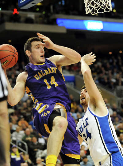 UAlbany's Sam Rowley, left, grabs the rebound as Dukes Ryan Kelly defends during their second round