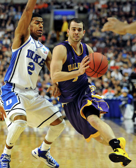 UAlbany's Jacob Iati, right, drives past Duke's Quinn Cook during their second round NCAA Tournament