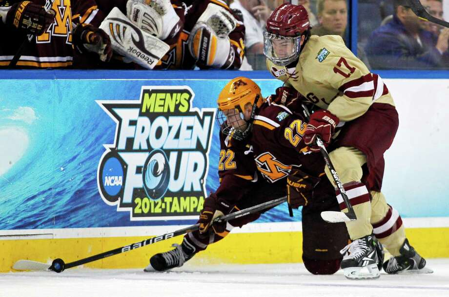 ADVANCE FOR WEEKEND EDITIONS, MARCH 23-24 - FILE - In this April 5, 2012, file photo, Minnesota's Travis Boyd, left, and Boston College's Destry Straight battle for the puck during the first period of an NCAA Frozen Four college hockey tournament semifinal game in Tampa, Fla. The unveiling of this year's field in the NCAA college hockey tournament on Sunday night will launch one of the most-anticipated tournaments for the sport in years. (AP Photo/Mike Carlson, File) Photo: MIKE CARLSON