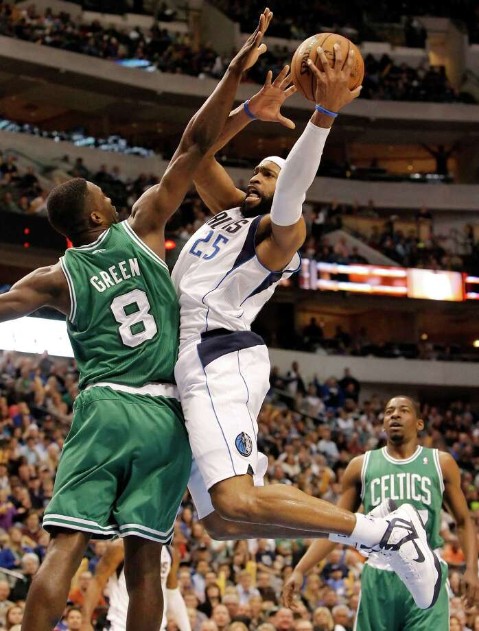 Dallas Mavericks' forward Vince Carter (25) goes up for a shot as Boston Celtics' forward Jeff Green (8) defends during the second half of an NBA basketball game on Friday, March 22, 2013, in Dallas. Dallas won 104-94. (AP Photo/Brandon Wade) Photo: Brandon Wade