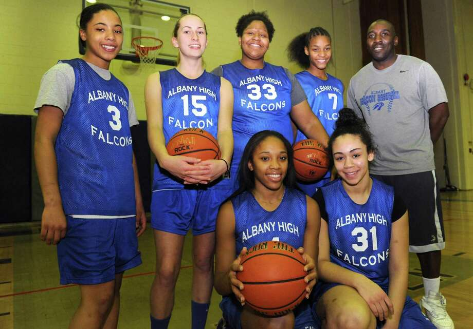 Albany High School girl's basketball starters, left to right Ayanna Hunter,Cara Waterson, Melissa Canty, Mylah Chandler, Emia Willingham Hurst, Ariel Greer and head coach Decky Lawson on Thursday Jan. 24,2013 in Albany, N.Y. (Michael P. Farrell/Times Union) Photo: Michael P. Farrell / 10020892A