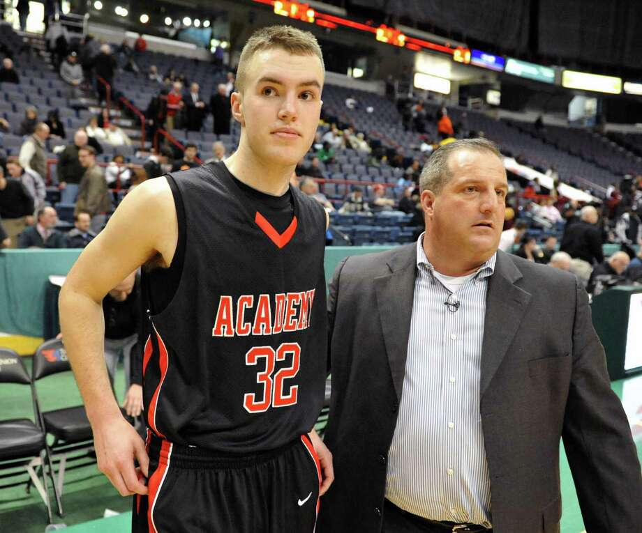 Albany Academy's #32 Jack Morrow, left, and head coach Brian Fruscio come out to speak with media after Morrow's last second basket beat Nazareth in the Class A Federation semifinal at the Times Union Center in Albany Friday March 22, 2013.  (John Carl D'Annibale / Times Union) Photo: John Carl D'Annibale / 00021669A