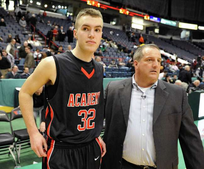 Albany Academy's #32 Jack Morrow, left, and head coach Brian Fruscio come out to speak with media af
