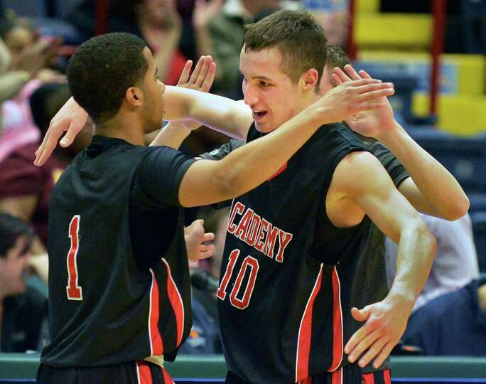 Albany Academy's #1, Darrien White, left, and #10 John Moutopoulos celebrate after beating Nazareth