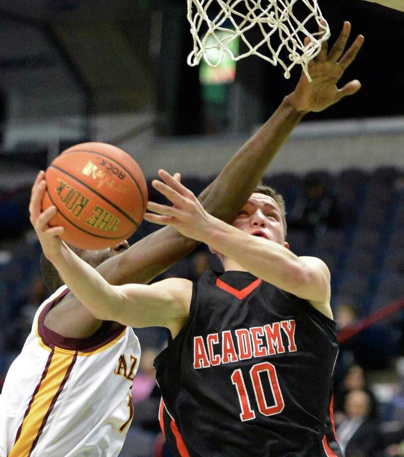 Albany Academy's #10, John Moutopoulos is fouled by Nazareth's #13 Samson Akilo,left, during their Class A Federation semifinal game at the Times Union Center in Albany Friday March 22, 2013.  (John Carl D'Annibale / Times Union) Photo: John Carl D'Annibale / 00021669A