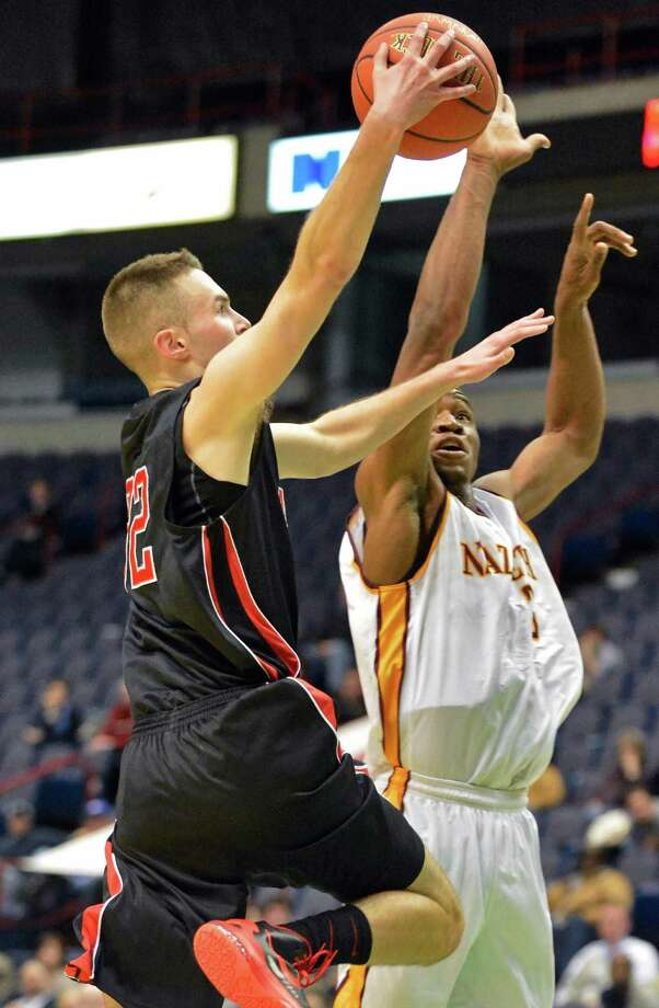 Albany Academy's #32 Jack Morrow gets a shot by Nazareth's #1 Norman Chandler during their Class A Federation semifinal game at the Times Union Center in Albany Friday March 22, 2013.  (John Carl D'Annibale / Times Union) Photo: John Carl D'Annibale / 00021669A