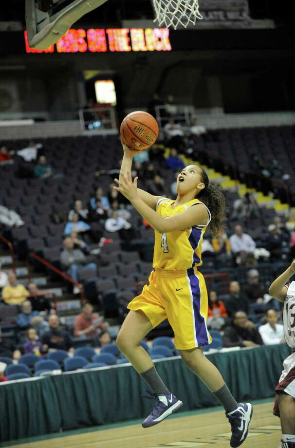 Troy's Mary Patterson (4) puts up a shot against Graphic Communications Arts' during the girls' Class A Federation Tournament of Champions semifinal basketball game in Albany, N.Y., Friday, March 22, 2013. (Hans Pennink / Special to the Times Union) High School Sports Photo: Hans Pennink / Hans Pennink