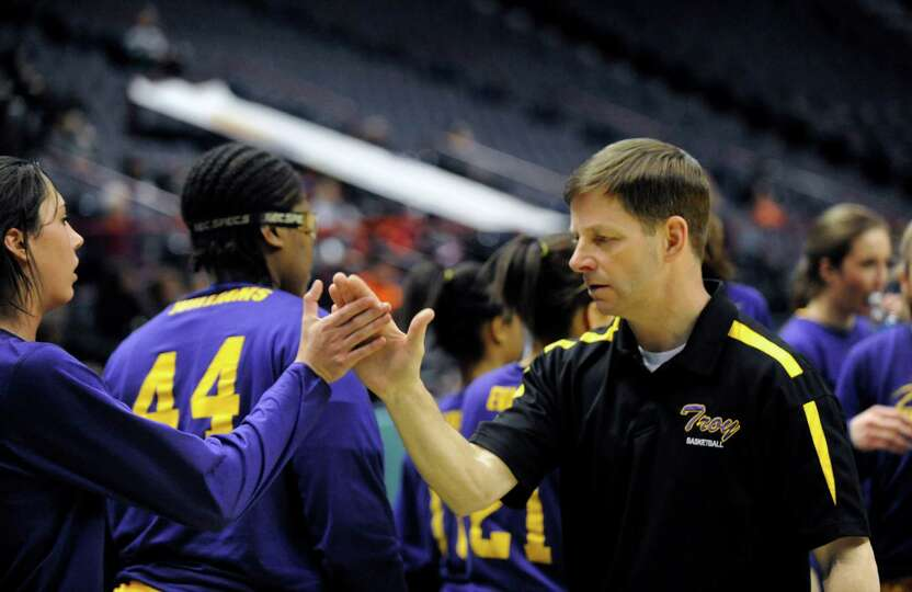 Troy head coach Paul Bearup celebrates a 65-33 win over Graphic Communications Arts' during the girl