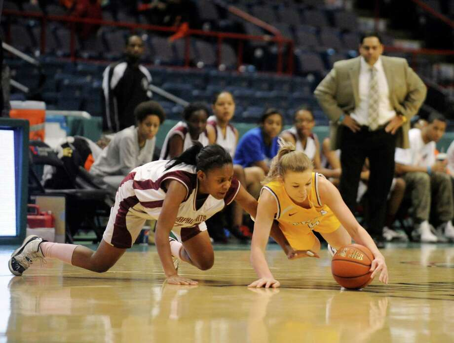 Graphic Communications Arts' Arians Spruill ,left, and Troy's Braylleigh Hanlon chase a loose ball during the girls' Class A Federation Tournament of Champions semifinal basketball game in Albany, N.Y., Friday, March 22, 2013. (Hans Pennink / Special to the Times Union) Photo: Hans Pennink / Hans Pennink