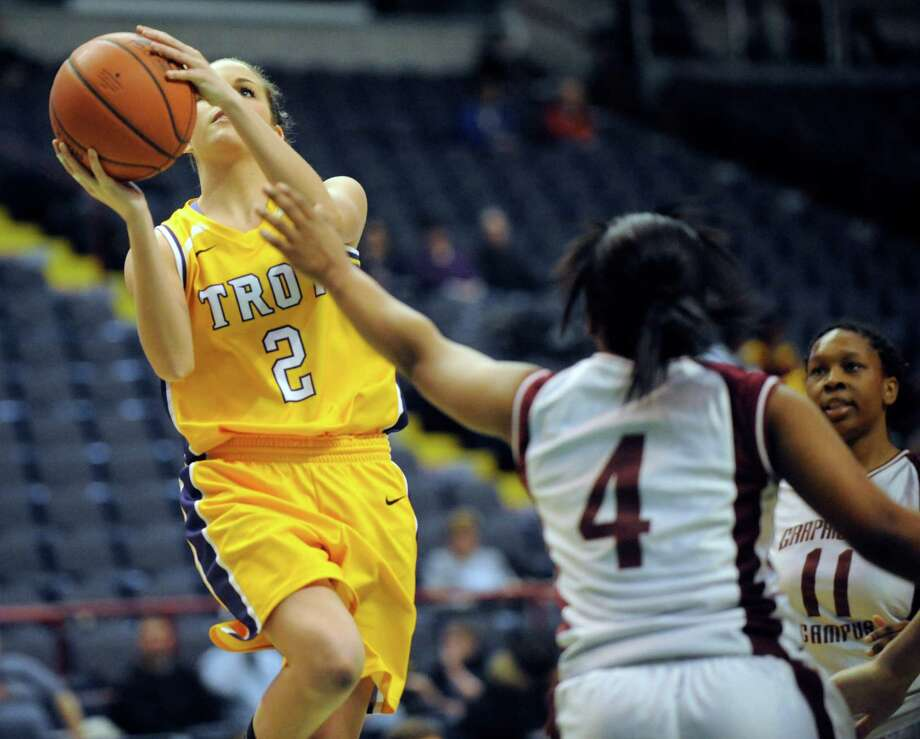 Troy's Meg Driscoll (2) is defended by Graphic Communications Arts' Linda Galay (4) during the girls' Class A Federation Tournament of Champions semifinal basketball game in Albany, N.Y., Friday, March 22, 2013. (Hans Pennink / Special to the Times Union) Photo: Hans Pennink / Hans Pennink