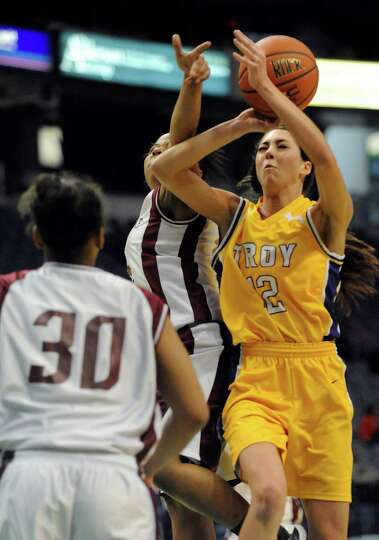 Troy's Courtney Avery (12) is fouled while shooting against Graphic Communications Arts during the g
