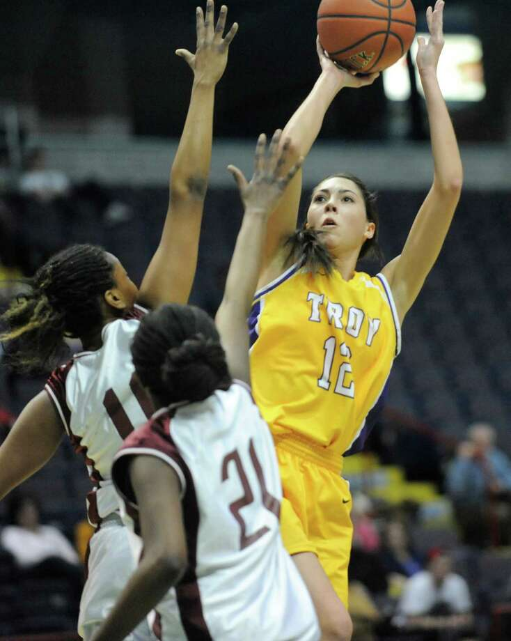Troy's Courtney Avery (12)  puts up a shot against Graphic Communications Arts during the girls' Class A Federation Tournament of Champions semifinal basketball game in Albany, N.Y., Friday, March 22, 2013. (Hans Pennink / Special to the Times Union) Photo: Hans Pennink / Hans Pennink