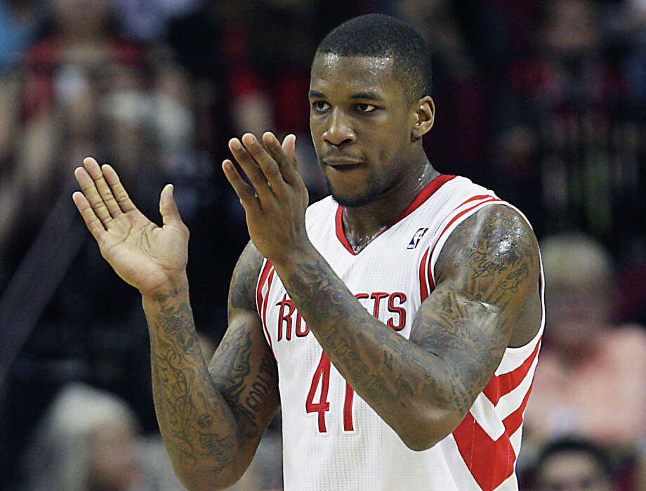 Thomas Robinson had reason to applaud his and the Rockets' effort in Friday's rout. Photo: James Nielsen, Staff / © 2013 Houston Chronicle