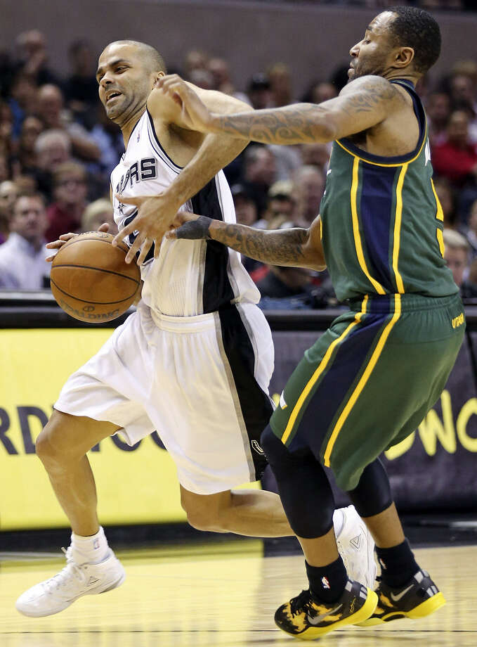 The Spurs' Tony Parker, looking for room around Utah's Mo Williams, had 22 points on 8-for-13 shooting in his first game after missing the past eight with a sprained left ankle. Photo: Edward A. Ornelas / San Antonio Express-News