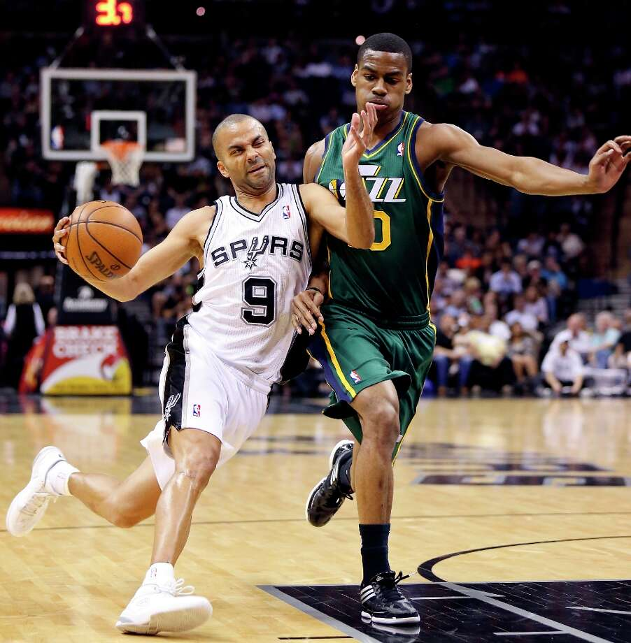 The Spurs' Tony Parker looks for room around Utah Jazz's Alec Burks during first half action Friday, March 22, 2013 at the AT&T Center. Photo: Edward A. Ornelas, San Antonio Express-News / © 2013 San Antonio Express-News