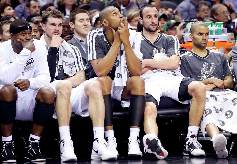 The Spurs' Stephen Jackson (from left), Tiago Splitter, Boris Diaw, Manu Ginobili, and Tony Parker sit on the bench during second half action against the Utah Jazz on Friday, March 22, 2013 at the AT&T Center. The Spurs won 104-97 in overtime. Photo: Edward A. Ornelas, San Antonio Express-News / © 2013 San Antonio Express-News