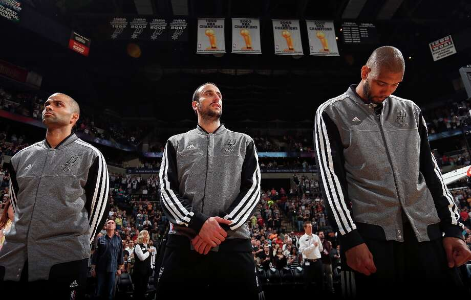 The Spurs' Tony Parker (from left), Manu Ginobili and Tim Duncan stand during the national anthem before the game with the Utah Jazz on Friday, March 22, 2013 at the AT&T Center. Photo: Edward A. Ornelas, San Antonio Express-News / © 2013 San Antonio Express-News