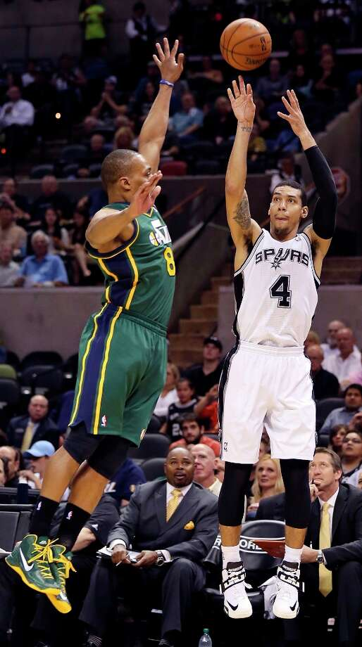 The Spurs' Danny Green shoots around Utah Jazz's Randy Foye during first half action Friday, March 22, 2013 at the AT&T Center. Photo: Edward A. Ornelas, San Antonio Express-News / © 2013 San Antonio Express-News