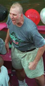Coach Gregg Popovich celebrates the Spurs' first NBA title while cruising down the Riverwalk during the city's victory parade on June 27, 1999. Photo: Rick Hunter