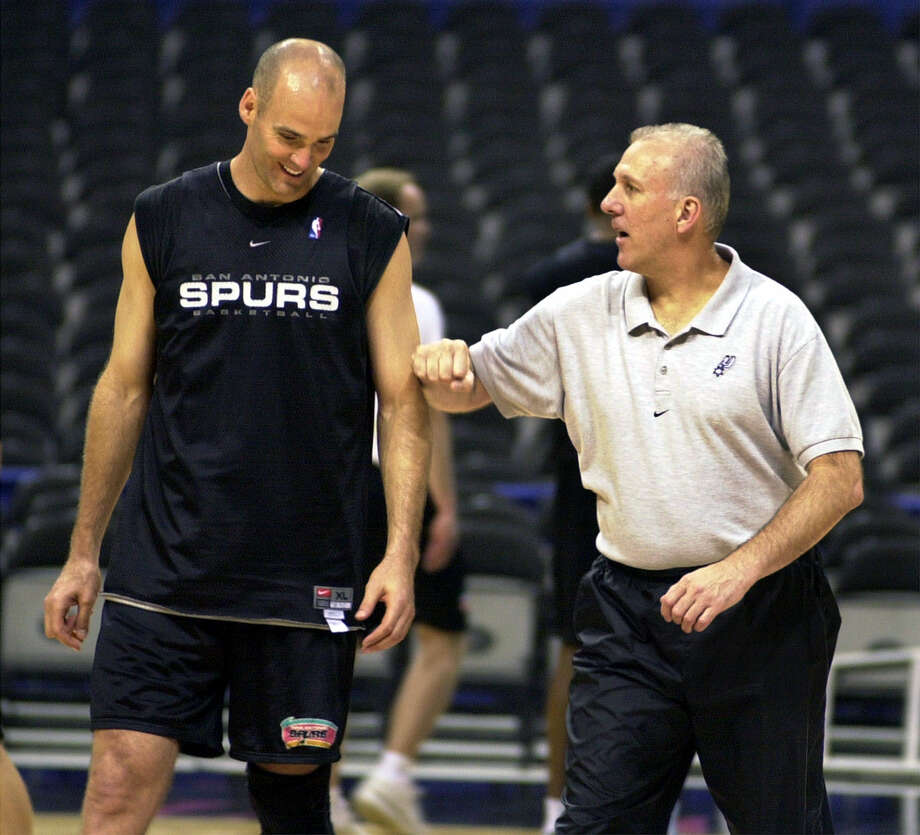 Spurs coach Gregg Popovich works with Danny Ferry during practice during the playoffs on May 16, 2001 at the Alamodome in San Antonio. Photo: KEVIN GEIL, SAN ANTONIO EXPRESS-NEWS / SAN ANTONIO EXPRESS-NEWS