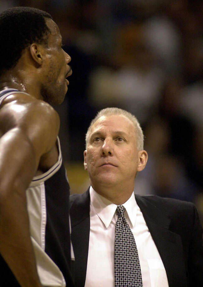 Spurs coach Gregg Popovich talks to David Robinson during a timeout in the third quarter against the Miami Heat in Miami on March 25, 2001. Photo: STEVE MITCHELL, AP / AP
