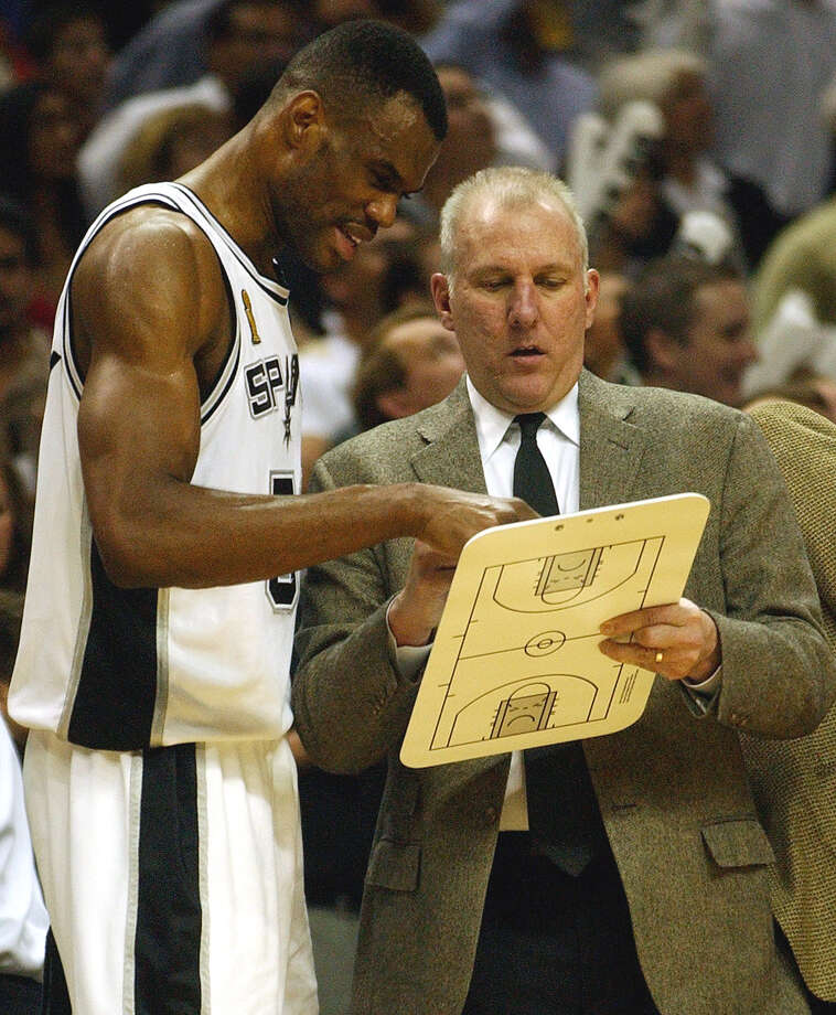 Spurs coach Gregg Popovich and David Robinson confer during the fourth quarter of Game 2 of the NBA Finals at the SBC Center on Friday, June 6, 2003. Photo: JERRY LARA, SAN ANTONIO EXPRESS-NEWS / SAN ANTONIO EXPRESS-NEWS