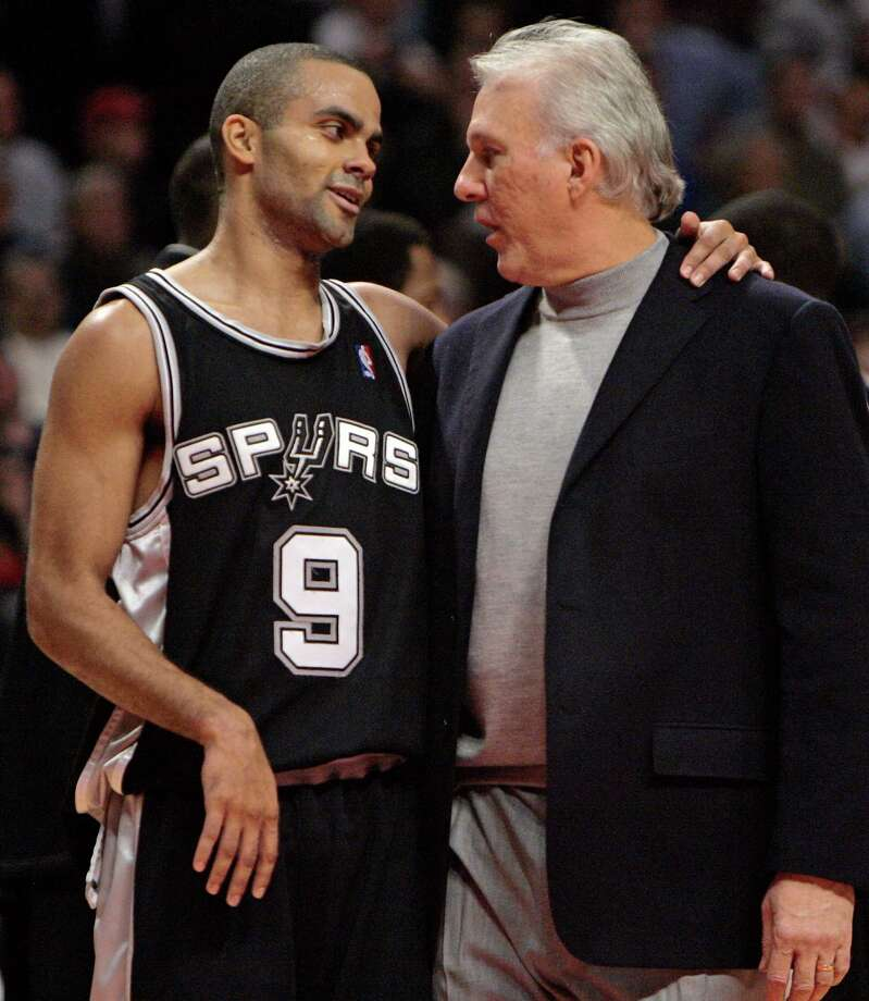 Spurs' Tony Parker smiles as he talks to coach Gregg Popovich during a timeout with less than a minute left in overtime against the Chicago Bulls Monday, Nov. 7, 2005,in Chicago. The Spurs won 104-95. Photo: JEFF ROBERSON, AP / AP