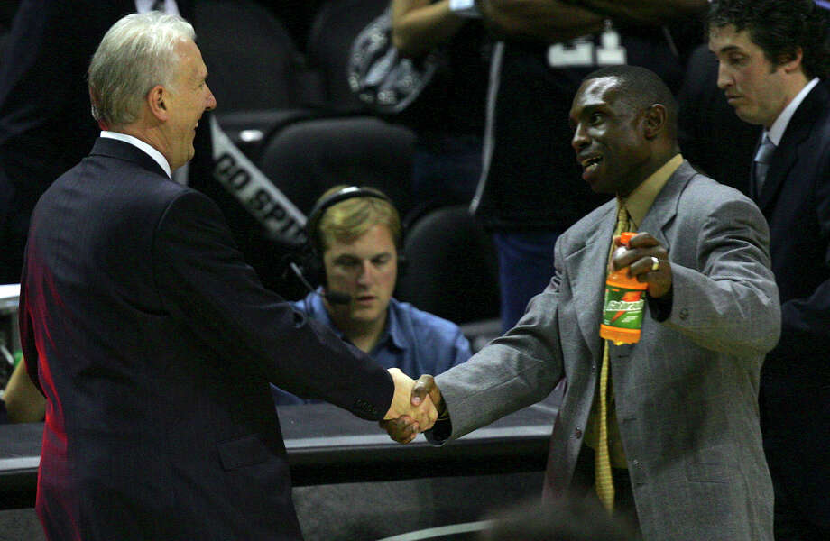 Gregg Popovich congratulates Avery Johnson after the Mavericks beat the Spurs 119-111 in overtime at the AT&T Center on May 22, 2006 in Game 7 of the NBA Western Conference semifinals. Photo: BAHRAM MARK SOBHANI, SAN ANTONIO EXPRESS-NEWS / SAN ANTONIO EXPRESS-NEWS