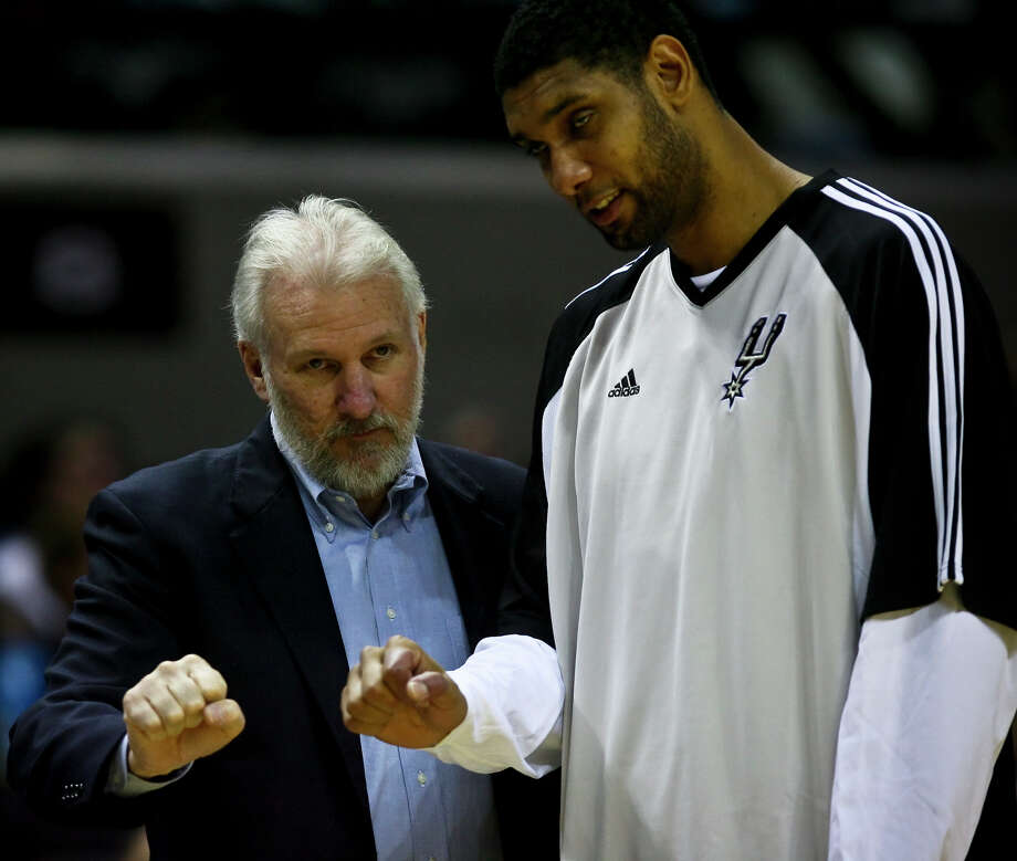 Gregg Popovich and Tim Duncan go over a play during a timeout in the fourth quarter of their preseason game  Oct. 22, 2008 at the AT&T Center. Photo: BAHRAM MARK SOBHANI, SAN ANTONIO EXPRESS NEWS / SAN ANTONIO EXPRESS NEWS
