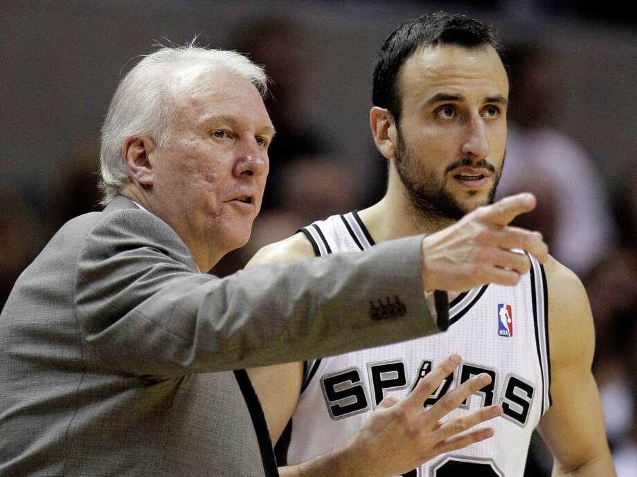Spurs coach Gregg Popovich (left) talks with Manu Ginobili during the fourth quarter against the Orlando Magic, in San Antonio on Nov. 22, 2010. Photo: Eric Gay, AP / AP2010