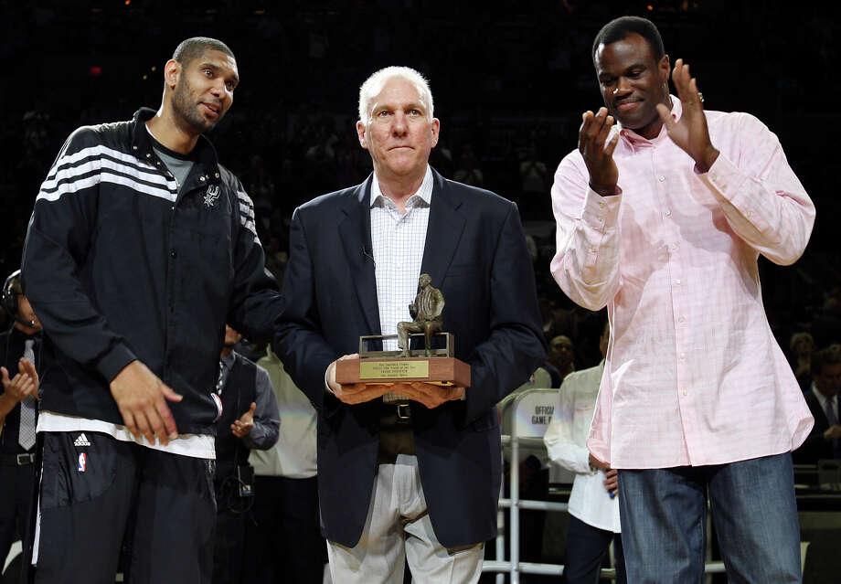 Spurs coach Gregg Popovich holds the Red Auerbach trophy as Tim Duncan and David Robinson look on before Game 2 of the Western Conference first round against the Utah Jazz Wednesday May 2, 2012 at the AT&T Center. Photo: EDWARD A. ORNELAS, SAN ANTONIO EXPRESS-NEWS / © SAN ANTONIO EXPRESS-NEWS (NFS)