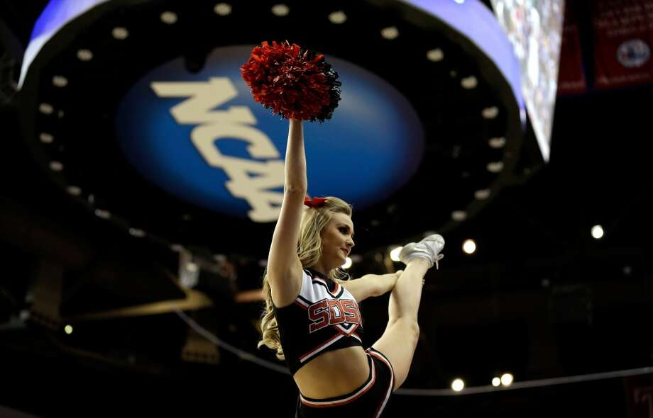 PHILADELPHIA, PA - MARCH 22:  A cheerleader for the San Diego State Aztecs performs against the Oklahoma Sooners during the second round of the 2013 NCAA Men's Basketball Tournament at Wells Fargo Center on March 22, 2013 in Philadelphia, Pennsylvania.  (Photo by Rob Carr/Getty Images)