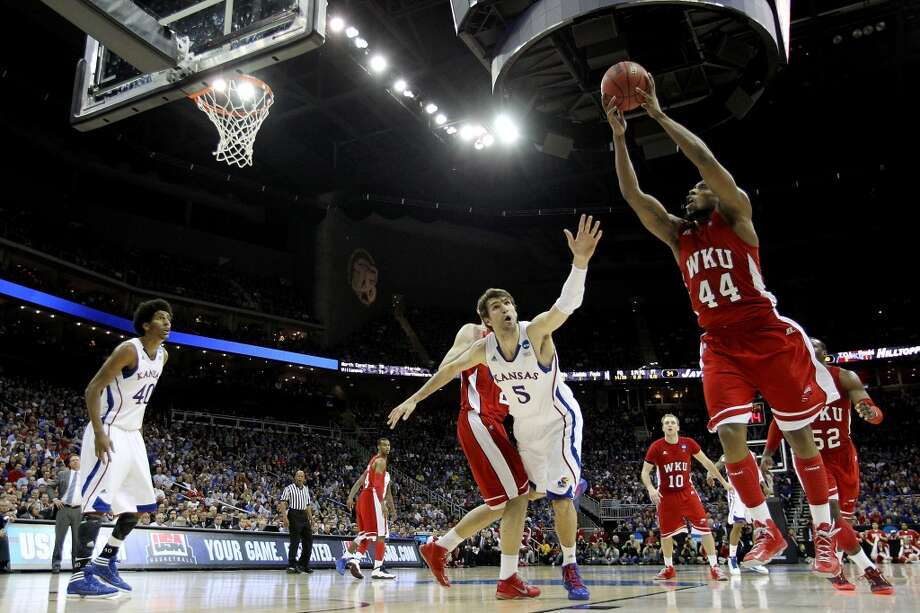 KANSAS CITY, MO - MARCH 22: George Fant #44 of the Western Kentucky Hilltoppers shoots against Jeff Withey #5 of the Kansas Jayhawks in the second half during the second round of the 2013 NCAA Men's Basketball Tournament at the Sprint Center on March 22, 2013 in Kansas City, Missouri. Kansas won 64-57. (Photo by Jamie Squire/Getty Images)