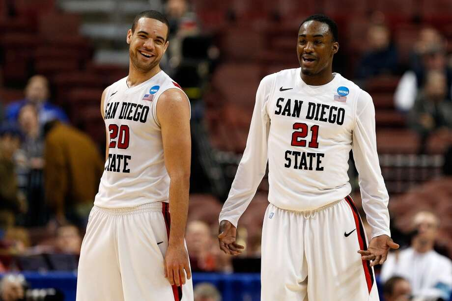 PHILADELPHIA, PA - MARCH 22: (L-R) JJ O'Brien #20 and Jamaal Franklin #21 of the San Diego State Aztecs smile on court against the Oklahoma Sooners  during the second round of the 2013 NCAA Men's Basketball Tournament at Wells Fargo Center on March 22, 2013 in Philadelphia, Pennsylvania.  (Photo by Rob Carr/Getty Images)