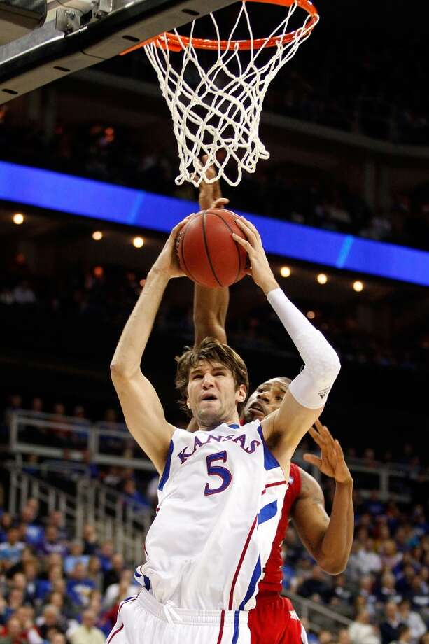 KANSAS CITY, MO - MARCH 22: Jeff Withey #5 of the Kansas Jayhawks rebounds against George Fant #44 of the Western Kentucky Hilltoppers in the first half during the second round of the 2013 NCAA Men's Basketball Tournament at the Sprint Center on March 22, 2013 in Kansas City, Missouri.  (Photo by Ed Zurga/Getty Images)