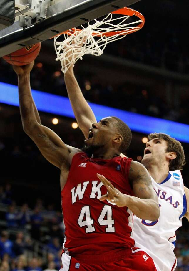 KANSAS CITY, MO - MARCH 22:  George Fant #44 of the Western Kentucky Hilltoppers shoots against Jeff Withey #5 of the Kansas Jayhawks in the second half during the second round of the 2013 NCAA Men's Basketball Tournament at the Sprint Center on March 22, 2013 in Kansas City, Missouri.  (Photo by Ed Zurga/Getty Images)