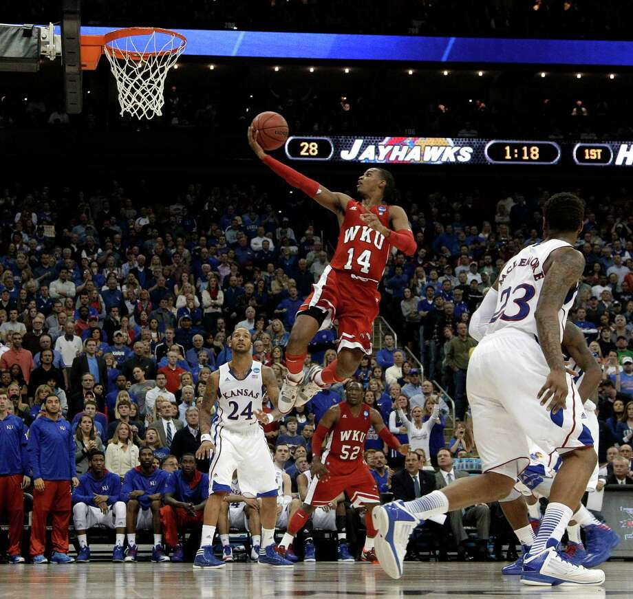 Western Kentucky guard Jamal Crook goes in for a shot during the first half of a second-round game against Kansas in the NCAA men's college basketball tournament Friday, March 22, 2013, in Kansas City, Mo. Photo: Charlie Riedel